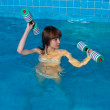 Pretty girl doing aqua aerobic exercise — Stock Photo #13770758