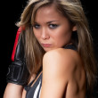 Pretty girl with boxing gloves — Stock Photo #14095492