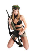 Attractive Woman with rifle — Stock Photo