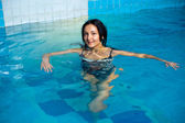 Attractive girl in swimming pool — Stock Photo