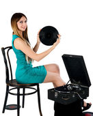 Pretty woman with gramophone — Stockfoto