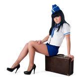 Young beautiful air hostess — Stock Photo