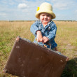 Stock Photo: Lonely girl with suitcase