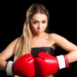 Beautiful nude girl with boxing gloves — Stock fotografie