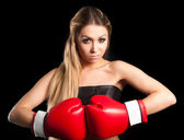 Beautiful nude girl with boxing gloves — Stock Photo