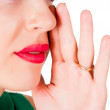 Cropped image of gossiping woman - Stock Photo