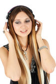Young blonde woman listening music — Stock Photo