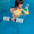 Attractive girl trains in aqua aerobics — Stock Photo #17047231