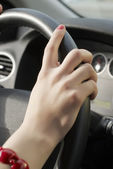 Girl hand on wheel steering — Stock Photo