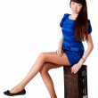 Woman is sitting on old leather suitcase — Stock Photo