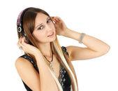Escuchar música joven rubia — Foto de Stock