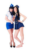 Two pretty stewardess with money — 图库照片