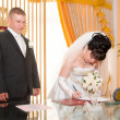 Elegant bride signing wedding contract - Foto Stock