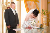 Elegant bride signing wedding contract — Stockfoto