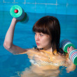Pretty girl doing aqua aerobic exercise — Stock Photo #18373887