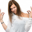 Stock Photo: Woman showing okay gesture