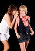 Girl Whispering in Friend`s Ear — Stock Photo
