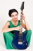 Pretty woman with guitar — Stock Photo