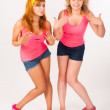 Duet of pretty girls dancing - Stock Photo