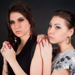 Portrait of two beautiful brunette women — Stock Photo