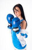Mooi meisje met bokshandschoenen — Stockfoto