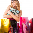 Blond woman with shopping bags... — Stock Photo