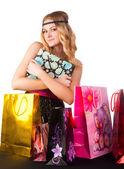 Mujer rubia con bolsas de compras... — Foto de Stock