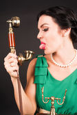Attractive woman showing tongue into phone — Stock Photo