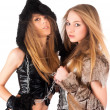 Two girl in barbarian and cat costumes — Stock Photo