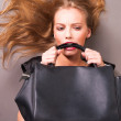 Stock Photo: Young beautiful woman with bag