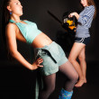 Danger girl with chainsaw — Stockfoto