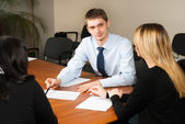 Young and successful businessman in the office — Stock Photo