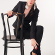 Young elegant woman on chair — Stock Photo