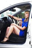 Attractive blonde woman driver — Stock Photo