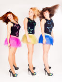 Three pretty girls dancing — Stock Photo