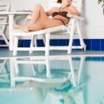 Girl near pool — Stock Photo #22688725