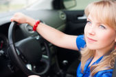 Attractive blonde woman driver — Stock Photo