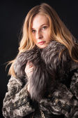 Attractive woman in fur coat — Stock Photo