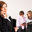 Businesswoman calling by phone in office — Stock Photo