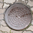 Old manhole - Stock Photo