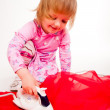 Royalty-Free Stock Photo: Little, blond hair girl ironing
