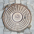 Stock Photo: Old manhole