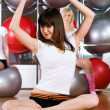 Pretty girls in fitness center — Stock Photo