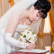 Pretty bride signing document — Stock Photo #23837665