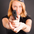 Pretty woman with a gun - Stock Photo