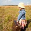 Stock Photo: Lonely girl with suitcase. Back view