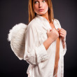 Young sexy woman with angel wings — Stock Photo