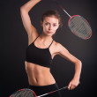 Beautiful girl with a rackets in hands — Stock Photo