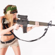 Beautiful sexy blond woman with sniper rifle — Stock Photo