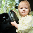 Little blond girl driving car — Stock Photo